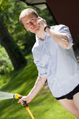 Businessman in garden — Stock Photo