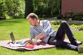 Businessman in garden — Stock Photo