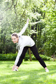 Woman practising in the park — Stock Photo