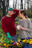 Tired couple working in garden — Stock Photo