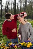 Couple having fun in garden — Foto de Stock