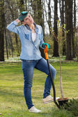 Tired woman digging in garden — Stock Photo