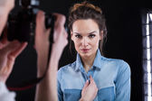 Woman posing during photo shooting — Stock Photo
