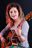 Girl playing and singing — Stock Photo