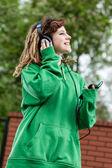 Rasta girl listening music — Stock Photo