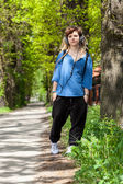 Rasta girl walking — Stock Photo