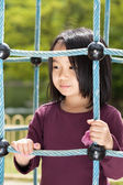 Cute girl playing on the playground — Stock Photo