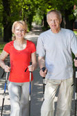 Married couple practicing nordic walking — Stock Photo