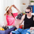 Young couple packing luggage — Foto de Stock   #48755979