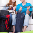 Woman and man putting up a tent — Stock Photo #48757417
