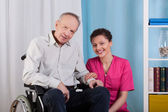 Disabled man and nurse — Stock Photo