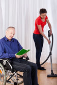 Nurse helping disabled — Stockfoto