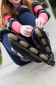 Girl putting rollers — Stock Photo