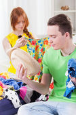 Girl and boy choosing clothes — Stok fotoğraf