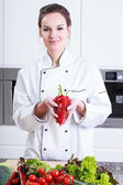 Cook presents peppers — Stock Photo
