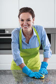 Housewife cleans the worktop — Stock Photo