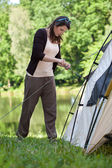 Girl trying to pitch a tent — Stock Photo