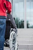 Man on wheelchair before work — Stock Photo