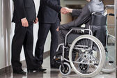 Disabled man and boss — Stock Photo