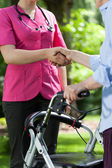 Nurse and disabled — Stock Photo