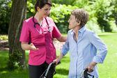 Nurse talking with lady — Foto Stock