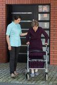 Elderly lady with walker — Foto Stock