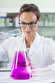 Woman doing experiment — Stock Photo