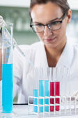 Scientist researcher using a pipette — Stock Photo