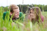 Couple lying on a meadow — Stock Photo