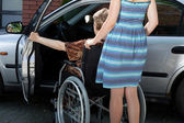 Woman helping disabled — Photo