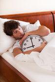 Asleep man with clock — Stock Photo