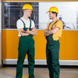 Factory workers standing with arms crossed — Stock Photo #49353997