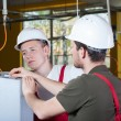 Two specialists repairing factory machine — Stock Photo #49354927