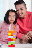 Asian family and their castle — Stock Photo