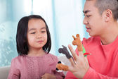 Family having fun with hand puppets — Stock Photo