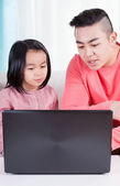 Asian family playing on the computer — Stock Photo