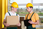 Storekeepers during work at warehouse — Stock Photo