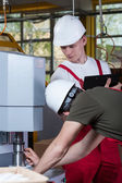 Man demonstrating factory machine to inspector — Stock Photo