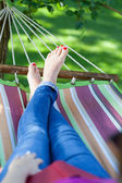 Woman relaxing on a hammock — Stock Photo
