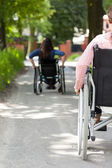 Disabled women on wheelchair outdoors — Stock Photo