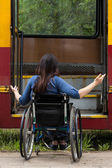 Girl on wheelchair having problem with entering the tramway — Stock Photo