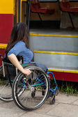 Woman of wheelchair having problem with public transport — Stock Photo