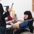 Disabled woman on wheelchair talking with manager — Stock Photo #49423751