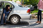 Girl taking wheelchair from car — Stock Photo