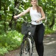 Girl and her bicycle — Stock Photo #49500857