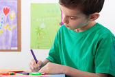 Boy paints on art lessons — Stock Photo