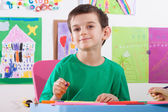Boy on art lessons at school — Stock Photo