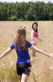 Girls on a field of grain — Stock Photo