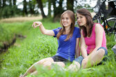 Girls sitting on a glade — Stock Photo