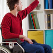 Disabled man taking book  — Stock Photo #49613239
